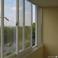 Установка раздвижных окон на балконе..